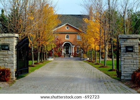 A long driveway to a beautiful country estate