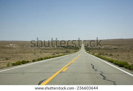A long endless road in america - stock photo