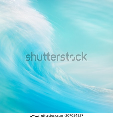 A long exposure abstraction of an ocean wave breaking onshore.