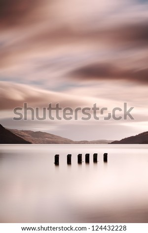 A long exposure of a flooded jetty on the shores of Loch Lomond, Scotland - stock photo