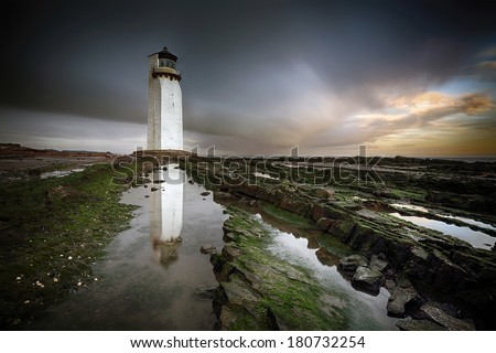 A long exposure of Southerness Lighthouse, Scotland on a gloomy evening just before Sunset.