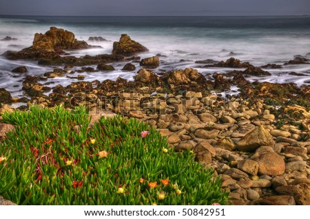 A long exposure of Spanish Bay on the Pacific Coast along 17 mile drive in Monterey. - stock photo