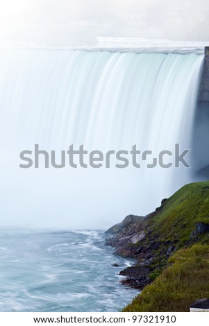 A long exposure of the falling water at Niagara shows a dreamy, misty view. - stock photo
