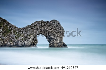 A long exposure of the sea arch named Durdle Door in Dorset on the South West Coast of the United Kingdom.