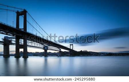 A long exposure of the Tamar Bridge at dusk looking towards Saltash on the Cornwall side