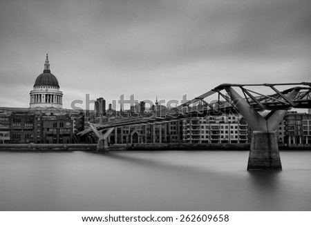 A Long Exposure shot of St Paul's Cathedral overlooking the River Thames and the Millennium Bridge. London, UK. - stock photo