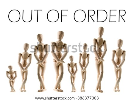 A long line of wooden figures are patiently waiting to go to the bathroom.