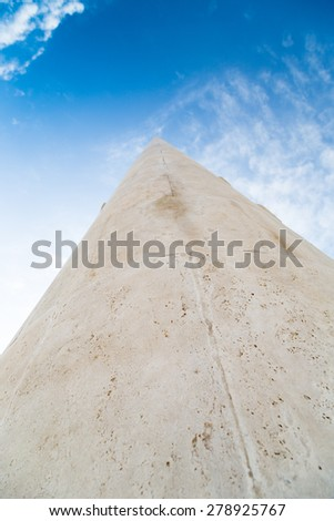 A long stone tip going to vanishing point at the horizon on a sky background