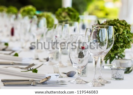A long table is being set for a special occasion.