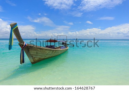 A long tail boat on a beach in Thailand