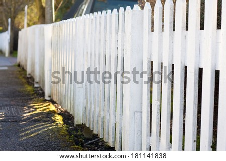 A long white picket fence - stock photo