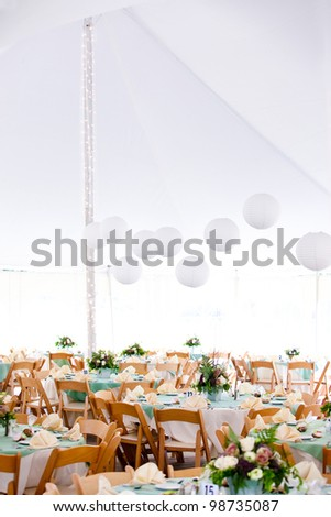 A look inside a tent set for fine dining during a wedding or other catered event