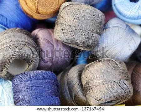 a lot bags of wool yarn thread - stock photo
