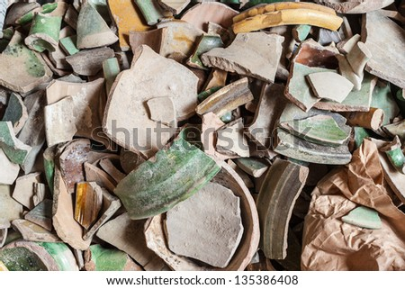 a lot of antique and dirty crockery of archeological interest - stock photo