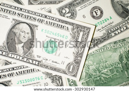 A lot of banknotes 1 and 2 US dollars