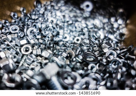a lot of bolts and nuts in a hardware store - stock photo