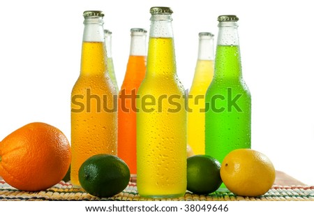 A lot of bottles with tropical drinks on white background - stock photo