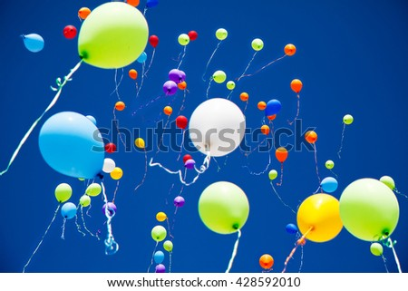 a lot of bright colorful balloons in the sky - stock photo