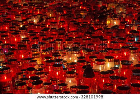 A lot of Candles Burning At a Cemetery During All Saints Day - stock photo