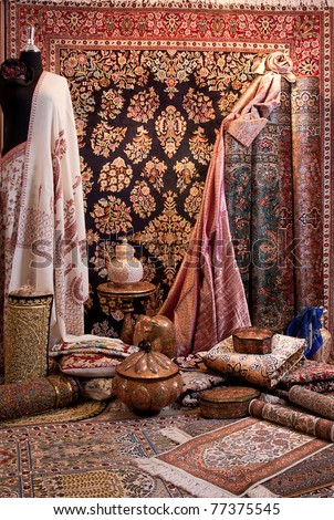 A lot of carpets and clothes shown in carpet shop