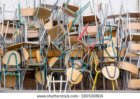 a lot of chairs arranged in a pile - stock photo
