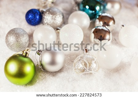 A Lot Of Christmas Baubles On Snowy Background