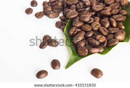 a lot of coffee beans on the white ground