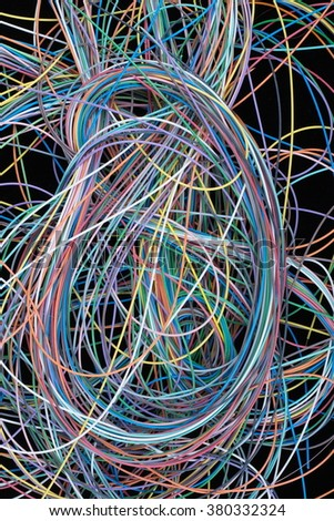 A lot of colored wires in global telecommunications networks on a black background. - stock photo