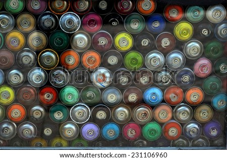 A lot of colorful Graffiti Aerosol Spray cans, ideal background/	Graffiti Spray Cans - stock photo