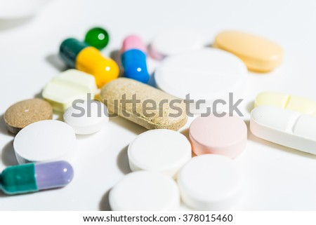 A lot of colorful medication and pills.