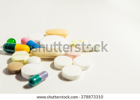 A lot of colorful medication and pills seen from above.
