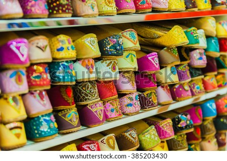 A lot of colorful shoes bazaar - stock photo