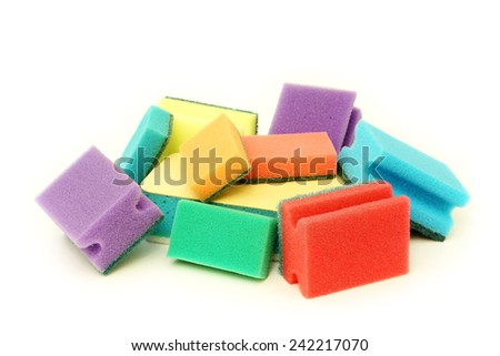 A lot of colorful sponges on a white background - stock photo