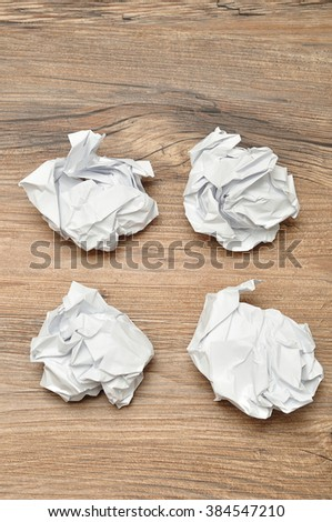 A lot of crumbled up pieces of paper