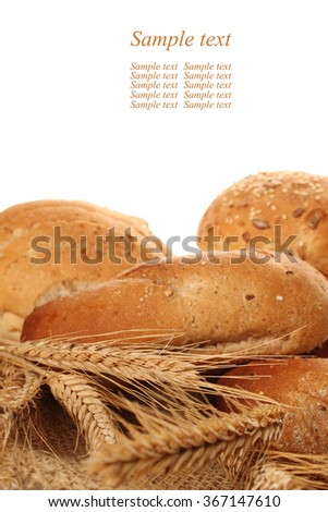 A lot of different breads are on sackcloth. isolate - stock photo