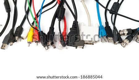 A lot of different computer cables and plugs isolated on white - stock photo