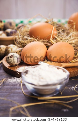 a lot of different  eggs and flour ,decorating for Easter