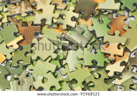 A lot of different size and color puzzles - stock photo