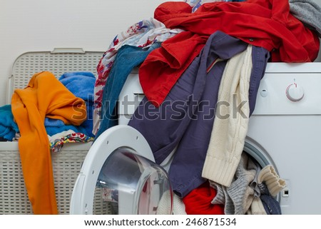 a lot of dirty clothes for the laundry - stock photo