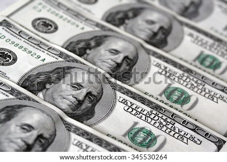A lot of 100 dollar bank-notes with shallow depth of field. Monetization. Several hundred dollars. International currency. Money. Landscape orientation - stock photo