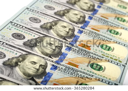 A lot of 100 dollar bank-notes with shallow depth of field. Money - stock photo