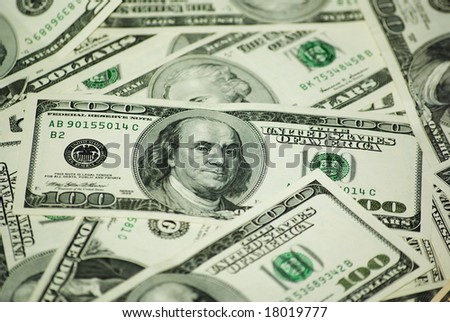 A lot of dollar banknotes. Focus on one hundred dollars banknote. - stock photo