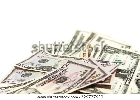 a lot of dollar bills on white background