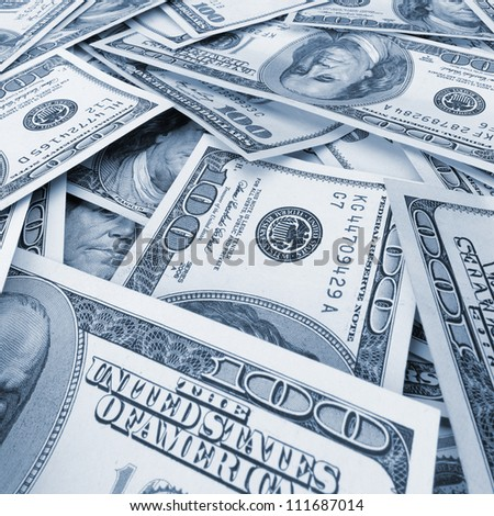 A lot of dollars.Highly detailed picture of American money. Blue toned - stock photo
