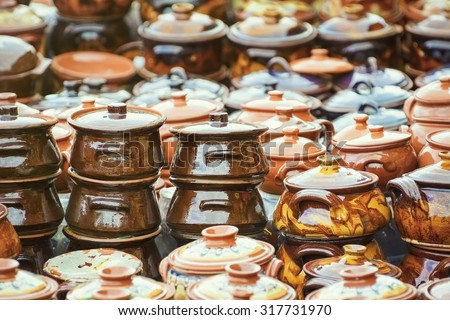 A Lot of Earthenware Crockery on the Pottery Market - stock photo