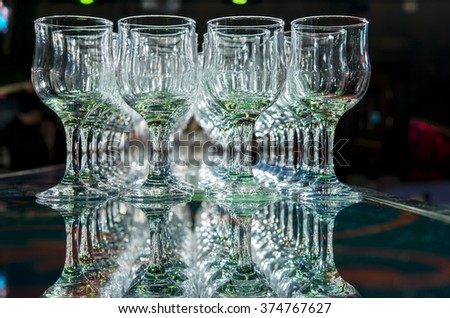 a lot of empty clean wine glasses on a dark background