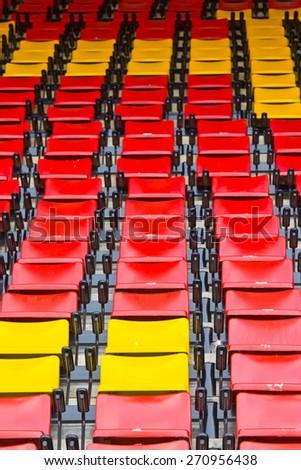 A lot of empty seats in stadium - stock photo