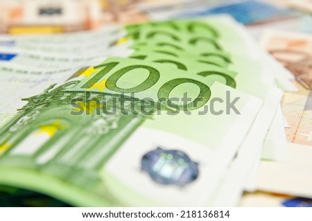 A lot of euro banknotes - large sum of money - stock photo