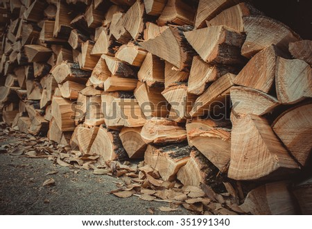 a lot of firewood outdoor, brown background - stock photo