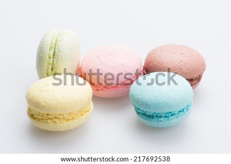 A lot of french colorful macarons on a white background